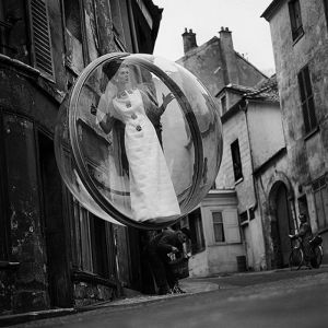 Woman floating in bubble over Paris